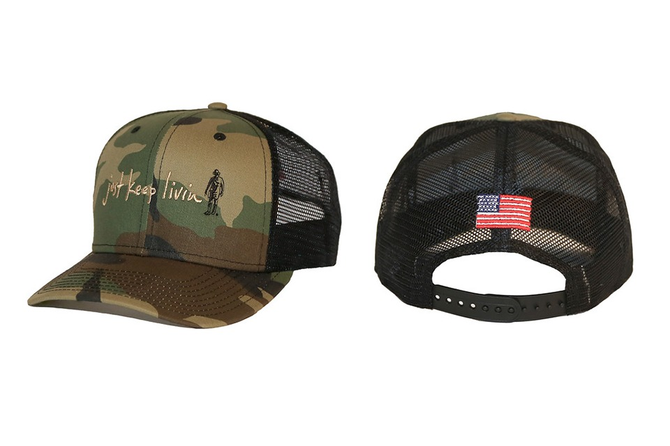 dbb18b7dae3 You will be on trend with this tried and true 950 trucker cap. Decorated  with a camo twill front